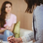 Young woman talking to counsellor