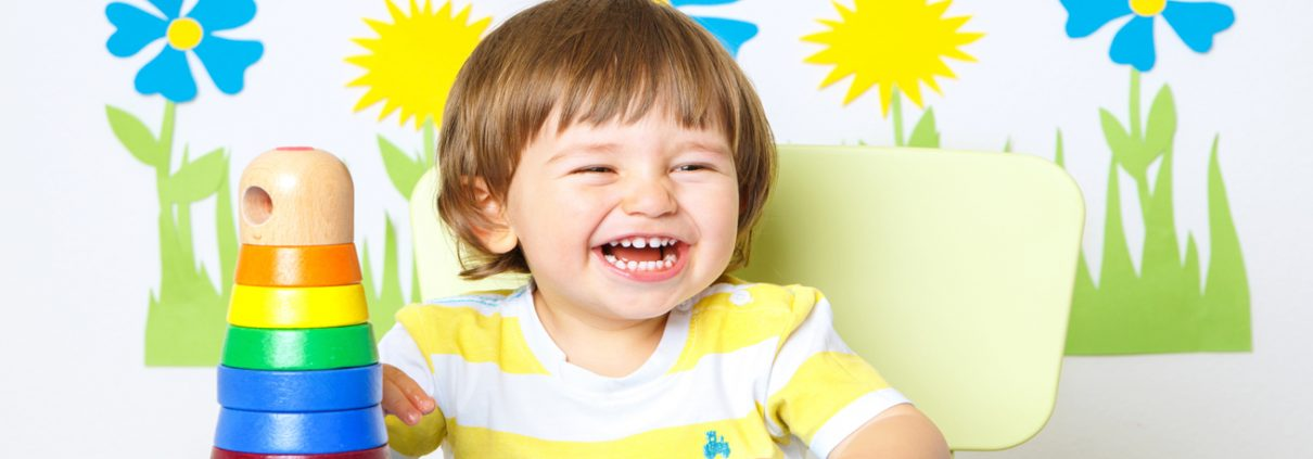 Small child laughing and playing