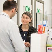 Woman talking to pharmacist