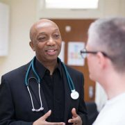 Male doctor talking to a patient
