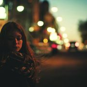 Young woman on the street at night