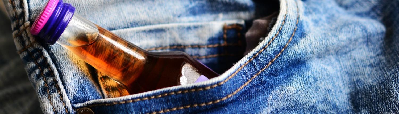 Bottle of alcohol in pocket
