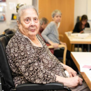 older lady with dementia looking at the camera